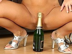 Champagne loving MILF gives a hot strip tease 0 mature sex pics
