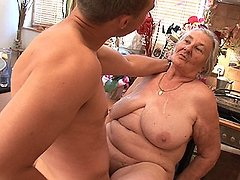 A fat older granny works on two younger cocks 0 mature sex pics