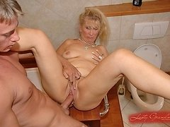 Blonde granny sits on young cock after blowjob 0 mature sex pics